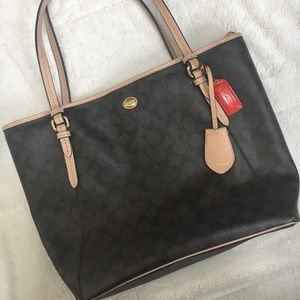Leather Coach purse with beige accents